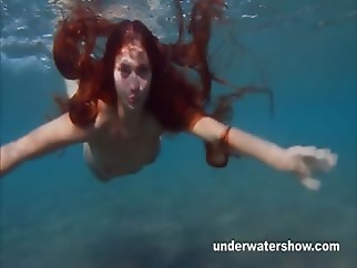 Julia is swimming underwater nude in the sea amateur brunette funny